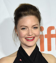 Holliday Grainger kept it simple yet classic with this loose bun at the premiere of 'The Riot Club.'