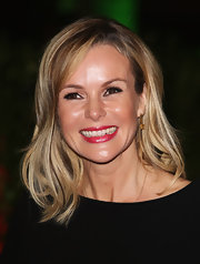 Amanda Holden's smile was brilliant in bright pink lipstick.