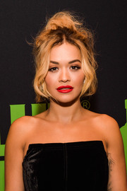 Rita Ora attended the Grammy Awards weekend kickoff wearing her hair in a messy-sexy updo.