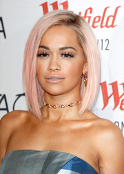 Rita Ora spiced up her look with a gold and diamond choker.