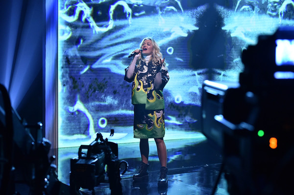 Rita Ora styled her suit with edgy combat boots.