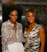 Solange paired her printed blouse with a geometric choker necklace.