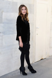 Elisa Sednaoui kept her all black style luxurious with a black velvet blazer with pushed up sleeves.