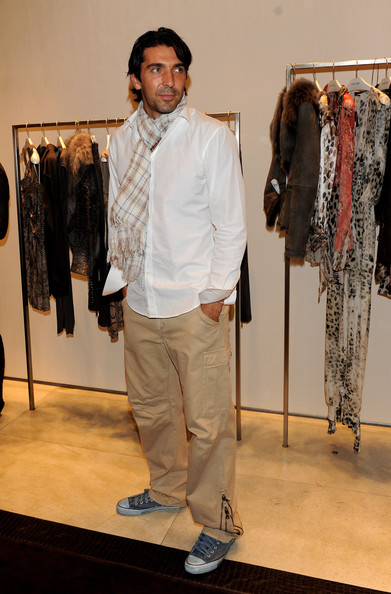 Gianluigi looked chic enough for Fashion's Night Out in Milan. Though, he did giveaway his star athlete status in well-worn blue All Stars.