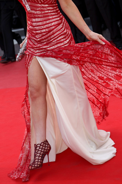 Miss Golan stood out in a bright red gown with a front slit that showed off a bold pair of red scalloped, cage ankle boots.
