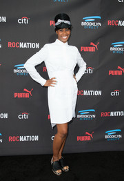 Santigold chose a simple white shirtdress for the Roc Nation pre-Grammy brunch.