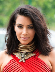 Kim Kardashian debuted a shorter 'do, which she wore in a messy-sexy style, at the Roc Nation pre-Grammy brunch.