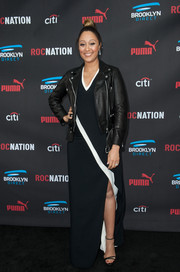 Tamera Mowry-Housley made an appearance at the Roc Nation pre-Grammy brunch wearing a black-and-white maxi dress.