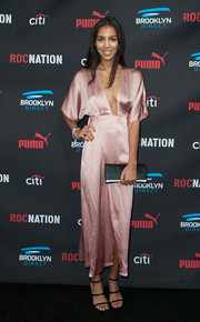 Arlissa Ruppert finished off her sexy ensemble with black strappy sandals.