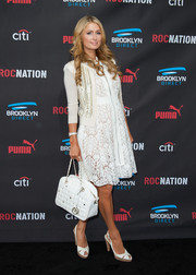 Paris Hilton completed her ladylike outfit with white peep-toe slingbacks by Stuart Weitzman.