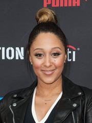 Tamera Mowry-Housley attended the Roc Nation pre-Grammy brunch wearing a zany top knot.