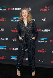 Kylie Minogue looked cool and cute in a sheer, polka-dot jumpsuit by Stella McCartney during the Roc Nation pre-Grammy brunch.