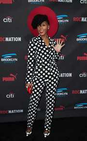Janelle Monae looked totally hip in a black-and-white polka-dot pantsuit by Moschino at the Roc Nation pre-Grammy brunch.