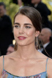 Charlotte Casiraghi added a dose of elegance with a pair of dangling diamond earrings.
