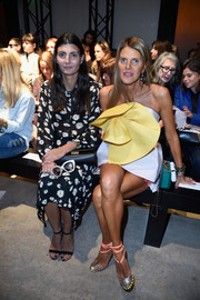 Giovanna Battaglia completed her modest outfit with a pair of black ankle-strap sandals.