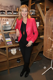Nina Ruge's black skinny pants were both stylish and simple when paired with a pink blazer.