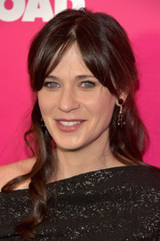 Zooey Deschanel styled her tresses into a loose half-up 'do for the New York premiere of 'Rock the Kasbah.'