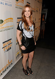 The actress paired her leather mini skirt with hot sip-front, sheer, peep-toed ankle booties.