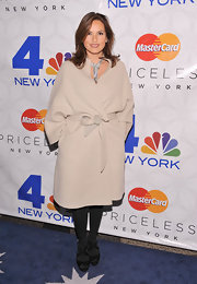 Mariska Hargitay hid her curves at the Rockefeller Center Christmas tree lighting ceremony in an oversize beige coat, which she tied at the waist.