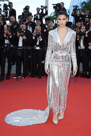 Sara Sampaio went for futuristic glamour in a silver Rami Kadi pantsuit with a long train at the 2019 Cannes Film Festival screening of 'Rocketman.'