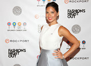 Olivia Munn was adorable at Fashion's Night Out in New York. A center part, a loosely wrapped and pinned French twist and voila!