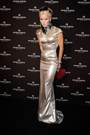 Daphne Guinness shined at the Soiree Monegasque wearing a silver evening gown with dramatic cap sleeves and a delicate train.