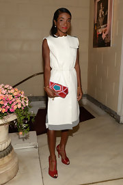 Genevieve Jones wore a pretty white dress with a gathered waist and gray details.
