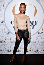 Jasmine Tookes attended the launch of Click My Closet wearing a cropped nude sweater.