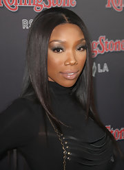 Brandy went for a sleek and sexy look while attending the Rolling Stone VIP party. The singer showed off long tresses while walking the red carpet.