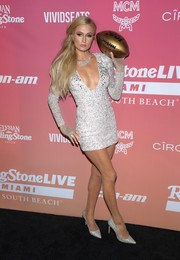 Paris Hilton flashed plenty of skin in a low-cut silver mini dress during Rolling Stone Live Miami.
