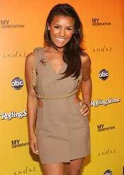 Melody wore a neutral,cutout mini dress with a rope-detailed bodice.