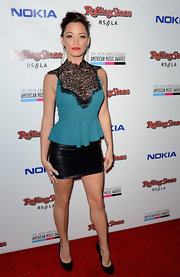 Jessica Sutta looked chic wearing a peplum top with lace detail on the chest at an event hosted by Rolling Stone Magazine.