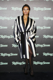 Kat Graham donned a boldly striped coat for the Rolling Stone party.