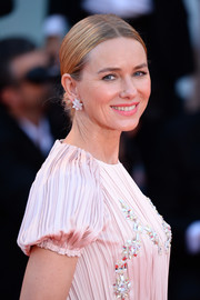 Naomi Watts styled her hair into a center-parted chignon for the Venice Film Festival screening of 'Roma.'