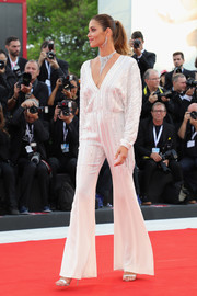 Ana Beatriz Barros was '70s-glam in an embellished bell-bottom jumpsuit by Alberta Ferretti Couture at the Venice Film Festival screening of 'Roma.'