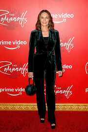 Diane Lane cut a stylish figure in a green velvet pantsuit by Akris at the New York premiere of 'The Romanoffs.'