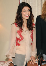 Alessandra Mastronardi exuded elegance in her sheer nude blouse embellished with red embroidery.