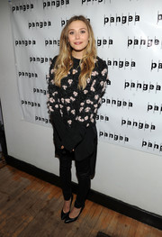 Elizabeth Olsen looked funky in an embellished Chloe crewneck sweater with a high-low hem during the 'Romeo and Juliet' after-party.