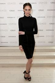 Coco Rocha complemented her dress with black ankle-strap platform sandals.