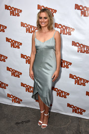 Taylor Schilling looked alluring in a gray satin slip dress at the premiere of 'Family at the Well.'