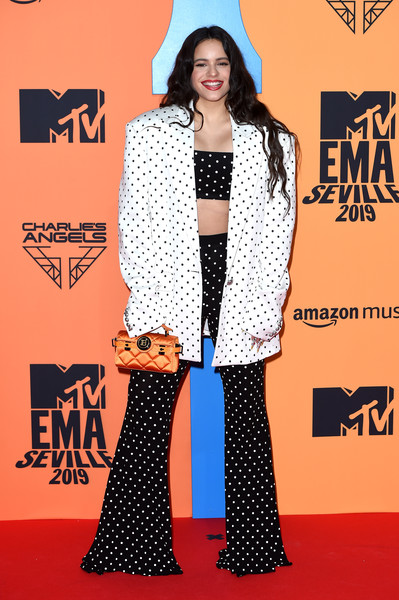 Rosalía Pantsuit [polka dot,clothing,pattern,carpet,red carpet,flooring,fashion,design,outerwear,premiere,red carpet arrivals,emas 2019,carpet,rosalia,red carpet,polka dot,clothing,pattern,mtv,fibes conference,rosal\u00eda,2019 mtv europe music awards,fibes - conference and exhibition,mtv europe,red carpet,award,mtv,2019]