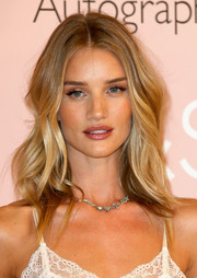 Rosie Huntington-Whiteley styled her hair with sexy waves for the Rosie for Autograph fragrance photocall.