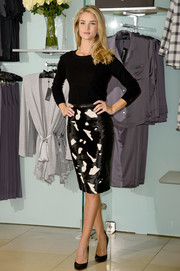 Rosie Huntington-Whiteley stylishly paired a long-sleeve sweater with an abstract-print pencil skirt for the launch of her lingerie collection.