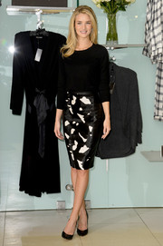 Rosie Huntington-Whiteley looked slim and stylish in a black-and-white pencil skirt and a fitted top during the launch of her lingerie collection.