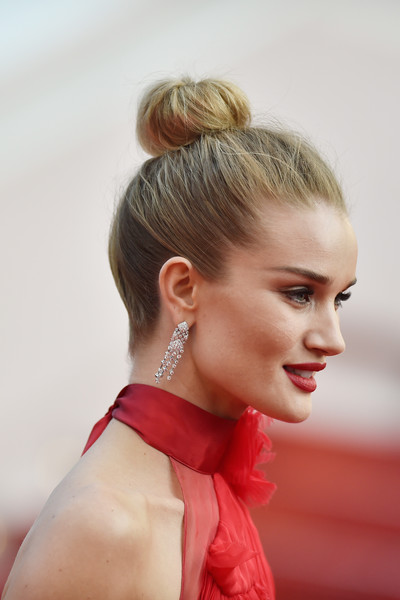 Rosie Huntington-Whiteley Classic Bun [the unknown girl,hair,hairstyle,beauty,human hair color,blond,bun,chignon,long hair,hair coloring,girl,premiere,rosie huntington-whiteley,cannes,france,red carpet arrivals,cannes film festival,palais des festivals]
