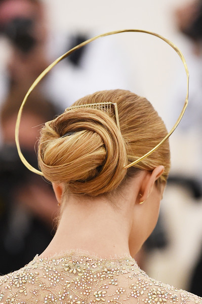Rosie Huntington-Whiteley Twisted Bun [heavenly bodies: fashion the catholic imagination costume institute gala - arrivals,hair,hairstyle,chignon,bun,fashion,headpiece,beauty,hair accessory,long hair,headgear,new york city,metropolitan museum of art,rosie huntington-whiteley]