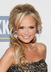 Kristin Chenoweth attended the Roundabout Theatre Company's 2012 Spring Gala wearing her voluminous locks in a low loose ponytail.
