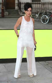 Nancy Dell'Olio chose a flowing white top and and matching sheer pants for her look at the Royal Academy of Art Summer Exhibit preview.