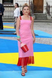 Florence Pugh coordinated her frock with red satin sandals by Rupert Sanderson.