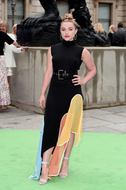 Florence Pugh added an extra pop of pastel with a pair of blue ankle-strap heels by Sophia Webster.